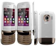 Nokia C202 con cargador original y Audífono speaker