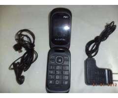 celular alcatel con audifono y cargador